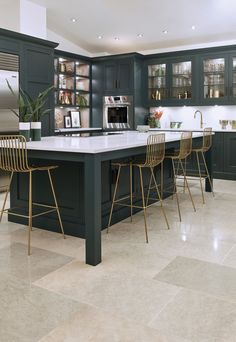 20 stunning dark kitchen ideas Why not match your cabinets to your kitchen island for some serious grown-up glamour? This dark sea-green kitchen unit with gold art-deco-style bar stools feels completely smart. Home Decor Kitchen, Kitchen Living, Kitchen Interior, New Kitchen, Kitchen Ideas, Kitchen Size, Country Kitchen, Smart Kitchen, Art Deco Kitchen