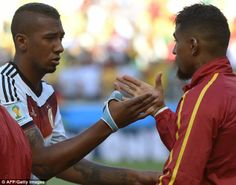 Shake on it: Jerome Boateng (left) and his brother Kevin-Prince Boateng before the match...