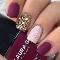 """One of the hottest accessories for fall 2015 are: cool, well-kept and eye-catching nails. Give your nails an injection of 'va va voom' by adorning a single nail with some gold rhinestones. The lace effect was created using a nail stamping technique. Products used: Laura G """"Madrid"""" + matte top coat."""