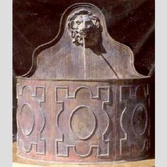 An English lead cistern with lion mask spout