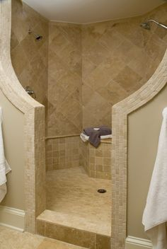 No glass...no cleaning the shower door! And 2 sides with separate shower heads. yes please