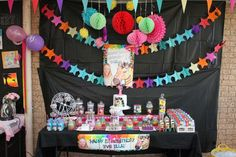 We themed the party with a piece of artwork my daughter had made - a neon zebra painting! This is the lolly buffet!