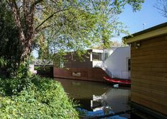 Copper-clad ParkArk houseboat by BYTR Architects floats on a Dutch canal