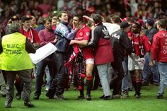 Eric Cantona celebrates with United fans after winning the Premier League in May 1993