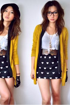 LOVE the mustard cardigan, and how it's longer than her skirt.
