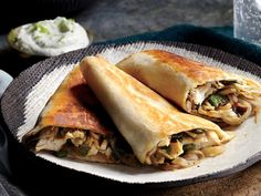 In this lightener chicken quesadilla recipe, a gentle poach keeps the chicken breast moist and tender, so it's easy to pull apart before ...