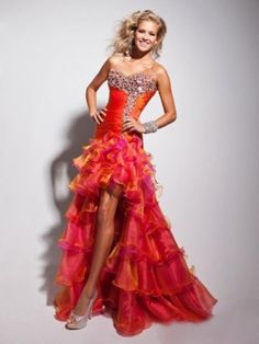 Head straight to the dance floor after slipping into this flamboyant Tony Bowls 113512 La Gala strapless dress. Two-tone ruffles float breezily down the hi-lo Orange Prom Dresses, High Low Prom Dresses, Unique Prom Dresses, Plus Size Prom Dresses, Gala Dresses, Prom Dresses Online, Pageant Dresses, Quinceanera Dresses, Homecoming Dresses