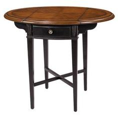 """Drop-leaf accent table with one drawer and a burl top.    Product: Accent table   Construction Material: MDF and wood   Color: Black and medium brown  Features: Burl edge details   One drawer   Tapered legs  Drop-leaf on each side  Dimensions: Without leaves: 25"""" H x 14.5"""" W x 23"""" DWith leaves: 25 H x 31 W x 23 D"""