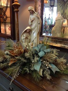 Blue and White Christmas-Love this nativity floral arrangement. Christmas decorating and centerpiece ideas. Christmas Floral Arrangements, Gold Christmas Decorations, Christmas Tablescapes, Rustic Christmas, Christmas Home, Christmas Holidays, Christmas Wreaths, Christmas Crafts, Christmas Nativity Scene