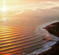 Endless sets roll onto the point at sunset. ..perfection