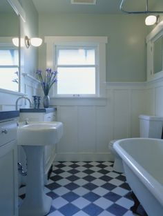 this is almost my bathroom layout but mine is bigger and this one is reno'd. Mine is bright green with white paneling, I want the two counters or something similar on either side of the sink.