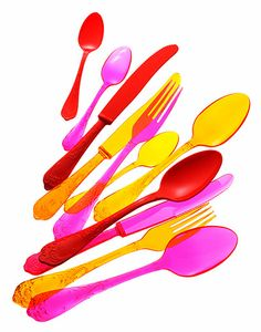 Colorful flatware adds the perfect touch to an outdoor party. #designsponge #dssummerparty