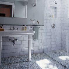 White porcelain sink, extra large subway tiles backsplash, frameless beveled mirror, chrome sconces and fixtures and pebble stone bathroom floor and pebble shower floor. Stone Bathroom, Master Bathroom, Basement Bathroom, White Bathroom, River Rock Bathroom, Small Bathroom, Seaside Bathroom, Bathroom Vinyl, White Shower