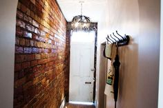 Sophie and Dale's Hallway. Love the vintage inspired hooks with the hats and umbrella hanging off. The chandelier is also pretty cool #theblock2012