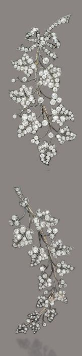 TWO ANTIQUE DIAMOND BROOCHES  Designed as a larger and a smaller branch of ivy leaves, the larger one with a tied ribbon at the base, both set throughout with old-cut diamonds, spring adapted, mounted in silver and gold, circa 1870.