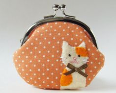 Hey, I found this really awesome Etsy listing at http://www.etsy.com/listing/113051639/coin-purse-marmalade-cat-on-orange-polka