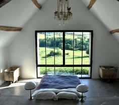 Bedroom with turned bed in a French farmhouse I Remodelista