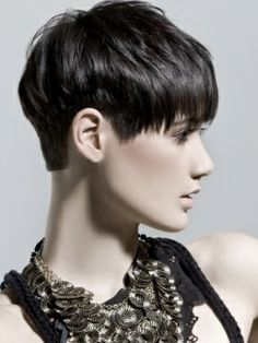 Textured short haircut with long bangs and cropped short in the back.