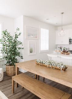 Lovely use of wood and white in this dining room/kitchen. Soften by the tree.