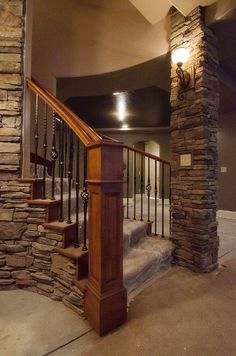 This snapshot is heavenly basement renovation ideas with stacked stone pilar decors and solid concrete flooring also solid hardwood railing. Description from gonev.com. I searched for this on bing.com/images