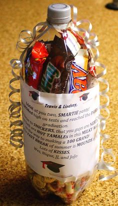 Graduation Gift Idea ~ this is great!  Just fill up with your imagination of what the grad would like (including money!), use school colors ribbons and such.  Cut a small square to 'fill' the bottle and place a 'tag' over it...Nice!