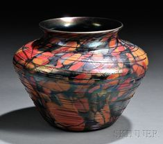 Rare Fenton Mosaic Vase  Art glass  West Virginia, c. 1925  Hand-blown with bits of colored glass in oranges, reds, and blue-green built into the form then spun with fine threading, interior in purple iridescence, some skips in the threading