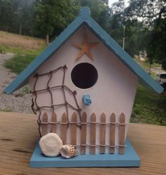 Sweet little beach house birdhouse! Painted a soft blue and white. Weathered…