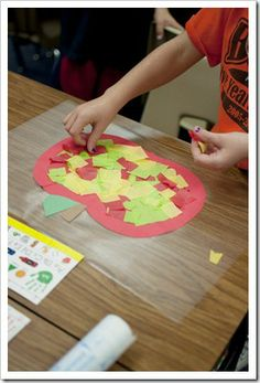 Apples, Apples, Everywhere! - tissue paper squares on contact paper put inside an apple-shaped frame