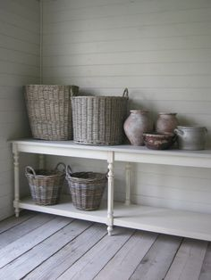 #baskets and simple #ceramics against walls and floors of #wood