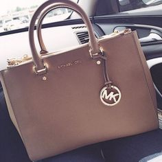 Saw a lady at Walmart wearing a tan purse, and  I was like, I like that. Then I saw an MK on the side and I was like, OOH I REALLY LIKE THAT!.... Pppffttt.. Rich people