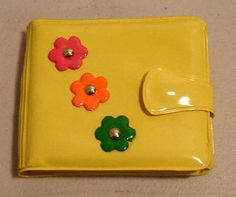 Groovy, flower power plastic wallet....omg...I remember having one of these!!! Bringing back memories!! ;)