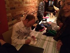 Alec Dempster signs copies of his book, Lotería Huasteca. Gladstone Hotel, November 2, 2015. Photo by Miles Dempster.
