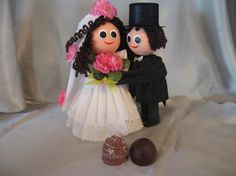 This adorable mini couple is a truffle box! The bride hides 2 fresh Swiss truffles under her dress. I used this for my cousin's engagement gift which she used as a cake topper at her wedding! contact@teuscher-bh.com 888-443-8992