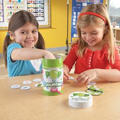 Pop for Counting™ Game  Lay the foundation for achieving grade K Common Core Math Standards (numeric representations) with this fast-paced, easy game for young learners! Pop cards feature numerals and sets of objects for children to count. Durable bubble-jar container includes guide printed on the outside, 80 bubble-shaped cards and spinner.