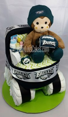 Philly style Philadelphia Eagles diaper cake bassinet designed with 100 diapers. Designed by BabyLuvsCakes
