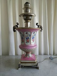 Check out this item in my Etsy shop https://www.etsy.com/listing/583834442/antique-french-lamp-empire-silver-plate