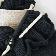 """Pattern for a knit throw blanket in a cool black yarn that is actually """"comprised of midnight blue, forest green, and gray tweed to add a little dimension to the black color"""". Would love to make this and use this yarn. Knitted Afghans, Knitted Blankets, Wool Throws, Wool Blanket, Chunky Blanket, Black Blanket, Easy Knit Blanket, Yarn Projects, Knitting Projects"""