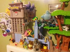 Pokemon! I love how the eevee figure is bigger than Diagla, Palkia, Charizard,and Typhlosion. Also that Riolu towers larger than all of them! xD