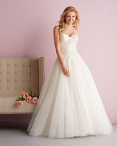 Allure Romance, 2708; This strapless ballgown features gossamer layers of English net falling from a ruched satin bodice with beaded embroidery detail at the front.