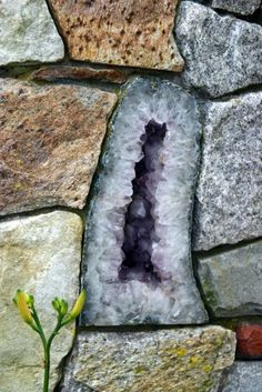 Geode built into a stone wall in the garden...lovely idea, plus many off-beat ideas for the garden