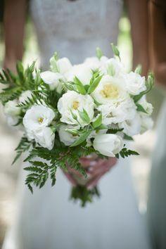 simple white bridal bouquet by Nicole Mora of Seed to Fruit, photo by Richard Israel | via junebugweddings.com