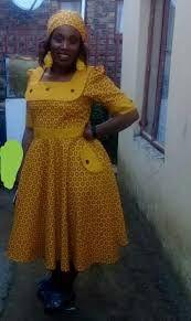 African Fashion – Designer Fashion Tips Sishweshwe Dresses, African Wear Dresses, African Attire, African Fashion Designers, African Print Fashion, Africa Fashion, South African Traditional Dresses, African Print Dress Designs, African Design