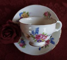A sweet vintage Mayfair cup and saucer. The set is decorated with lovely mixed season flowers. Perfect for that cup of tea on the lawn!c1950 by Alexsprettyvintage on Etsy