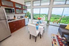 $250  ($30 cleaninf fit)  **5ppl/2Bdrm/3Bds/2Bath**  Listing on Airbnb: Modern hilltop 2-bedroom with ocean view and pool - Apartments for Rent in Rincon. Villa Montaña Rusa is a brand new, stunning house designed by cutting-edge New York architects. It is located in the hills of Rincon, close to all the popular beaches, great restaurants and the town center.  The house has breathtaking panoramic views of the ocean and the valley below from every room. You will love the 35 foot saline pool…