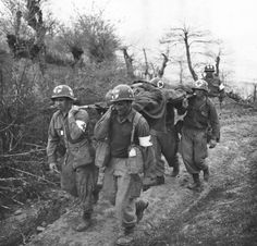 Medics of G Company, 87th Mountain Infantry, 10th Mountain Division, carry a wounded GI to an aide station during the fighting around Bologna, Italy on May 1, 1945.