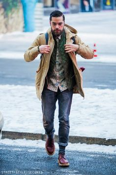 Red leather shoes, thick socks, rolled up pants and layered coats/shirts. Don't try too hard, lots of pieces can create interest if the colors work together.