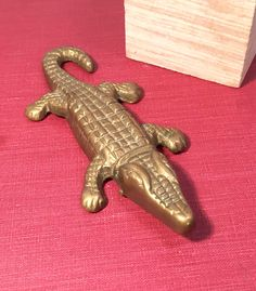A personal favorite from my Etsy shop https://www.etsy.com/listing/289189699/brass-alligator-figurine-brass-crocodile