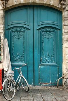 Double doors, Italian flair, deep turquoise blue...