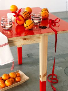 i like the idea of painting a simple wood table with gloss paint.
