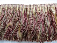 golds mauve pink wine green for pillowsfor upholsteryfor throwsfor curtains trimsfor valance trimand so much moreexquisite quality designer trimone yard or moreRegural retail on this trim would be or more per yardthanks for looking Curtain Trim, Upholstery Trim, Long Fringes, Mauve, Wine, Green, Valance, Curtains, Gold